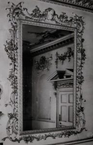 Poltimore House - Historic England photograph of the one of the large rectangular mirrors.